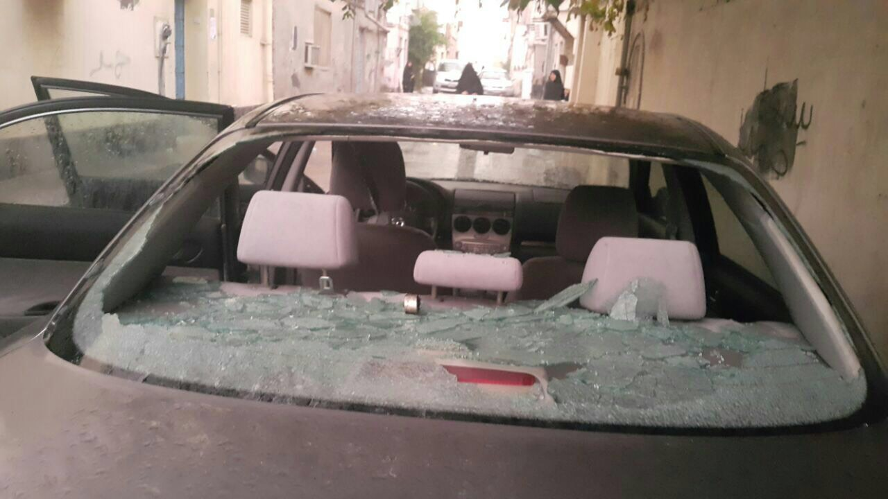 Damaged car during protests' attacks 13 February 2017