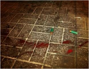 Blood of Mahdi Al-Qaffas after getting shot with shotgun